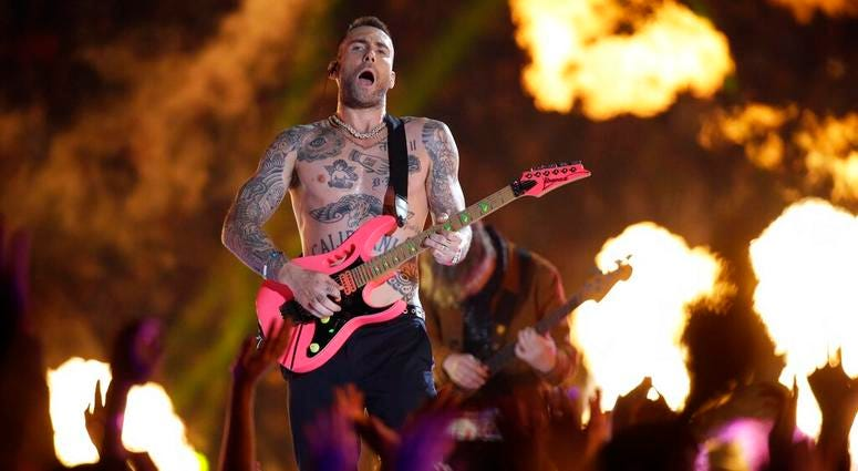 Adam Levine of Maroon 5 performs during halftime.