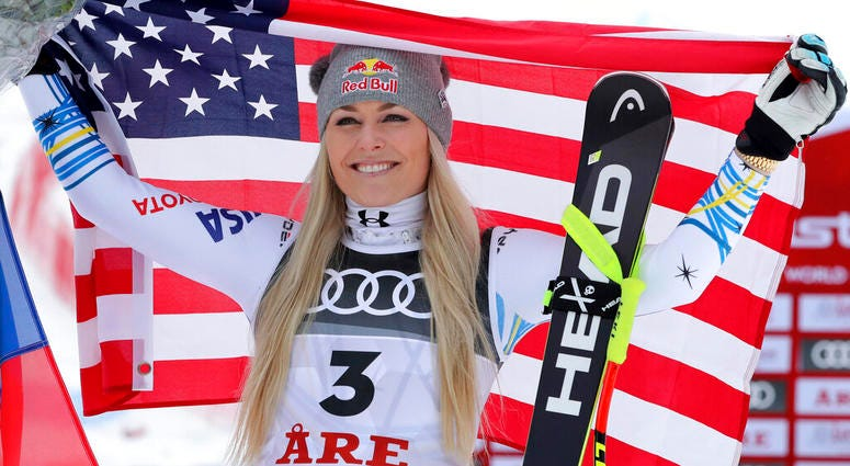 Bronze medalist United States' Lindsey Vonn celebrates after the women's downhill race, at the alpine ski World Championships in Are, Sweden, Sunday, Feb. 10, 2019.