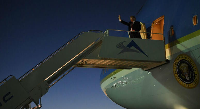 President Donald Trump walks down the steps of Air Force One at El Paso International Airport in El Paso, Texas, Monday, Feb. 11, 2019.