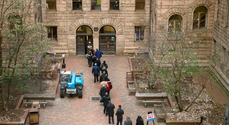 People arrive to the Allegheny County Courthouse prior to the start of the second day of the homicide trial of former East Pittsburgh police officer Michael Rosfeld March 20, 2019.