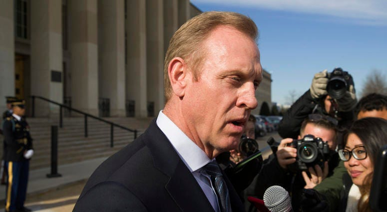 In this Jan. 28, 2019, file photo, acting Defense Secretary Pat Shanahan speaks with the media as he waits for the arrival of NATO Secretary General Jens Stoltenberg at the Pentagon in Washington.