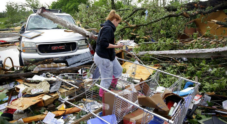 A tornado touched down near Tulsa International Airport amid storms in the Southern Plains that brought a deluge of rain and powerful winds, closing an interstate and flipping campers at a raceway.