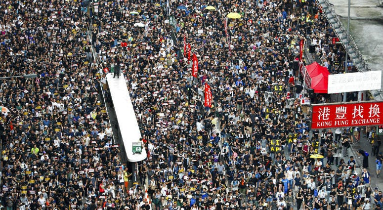 Protesters take part in a march on a street in Hong Kong, Sunday, July 21, 2019. Thousands of Hong Kong protesters marched from a public park to call for an independent investigation into police tactics.