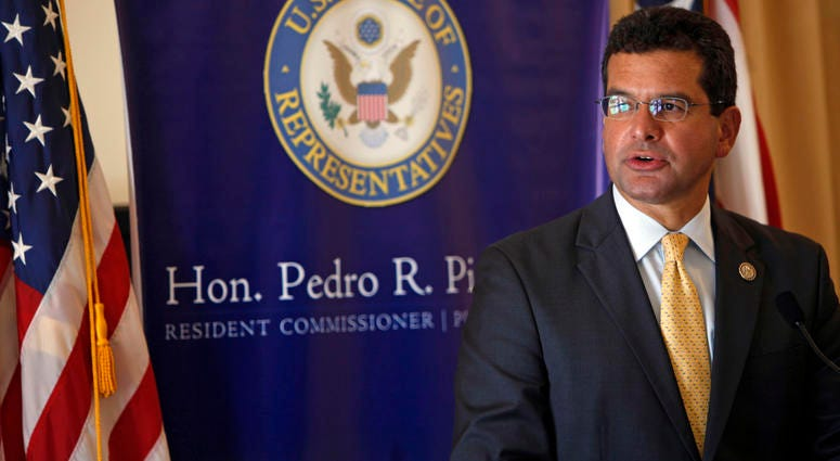 In this Sept. 24, 2013 file photo, Pedro Pierluisi, Puerto Rico's representative in the U.S. Congress, speaks during a conference in San Juan, Puerto Rico.