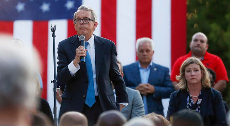 Ohio Gov. Mike DeWine, left, speaks alongside Dayton Mayor Nan Whaley, right, during a vigil at the scene of a mass shooting, Sunday, Aug. 4, 2019, in Dayton, Ohio.