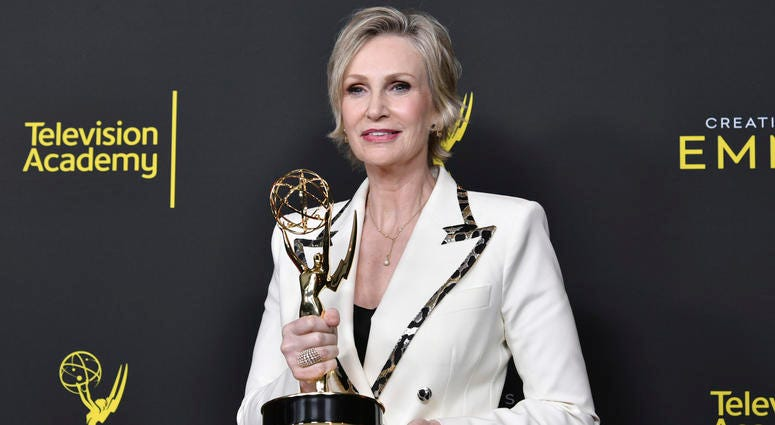 "Jane Lynch poses in the press room with the award for outstanding guest actress in a comedy series for ""The Marvelous Mrs. Maisel"" on night two of the Creative Arts Emmy Awards on Sunday, Sept. 15, 2019, at the Microsoft Theater in Los Angeles."