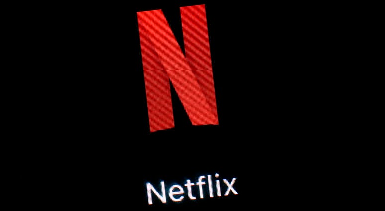 File photo shows the Netflix app on an iPad in Baltimore.