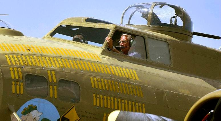 """B-17 pilot Ernest """"Mac"""" McCauley lands the B-17 flying fortress """"Nine O Nine"""" during the Wings of Freedom Tour at the Hazleton Regional Airport in Hazleton, Pa."""