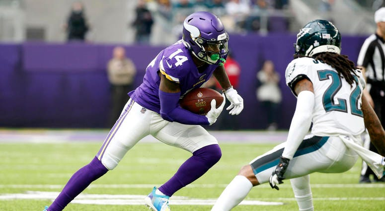 Minnesota Vikings wide receiver Stefon Diggs, left, runs from Philadelphia Eagles cornerback Sidney Jones, right, after catching a pass during the first half.