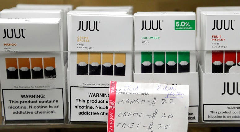 uul products are displayed at a smoke shop in New York. On Thursday, Oct. 17, 2019, the company announced it will voluntarily stop selling its fruit and dessert-flavored vaping pods.