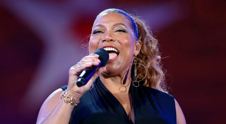 Queen Latifah performs during the dress rehearsal for the Boston Pops Fireworks Spectacular in Boston.