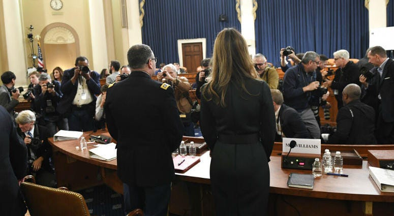Jennifer Williams, right, an aide to Vice President Mike Pence, and National Security Council aide Lt. Col. Alexander Vindman, stand to take a break.