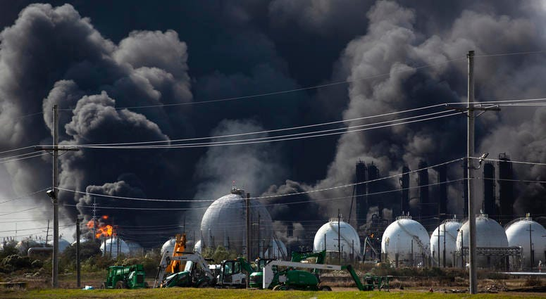 Smoke from an explosion at the TPC Group plant is seen Wednesday, Nov. 27, 2019, in Port Neches, Texas