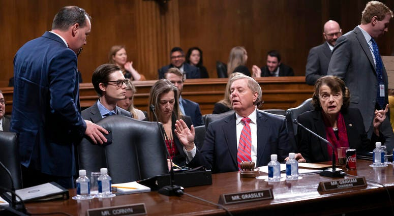 Senate Judiciary Committee Chairman Lindsey Graham, R-S.C., right, speaks with Sen. Mike Lee, R-Utah, a member of the panel.