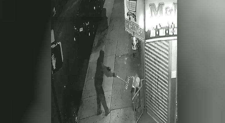 Screencap of surveillance video of a man who disposed of the dead cat after finding it outside a corner store.