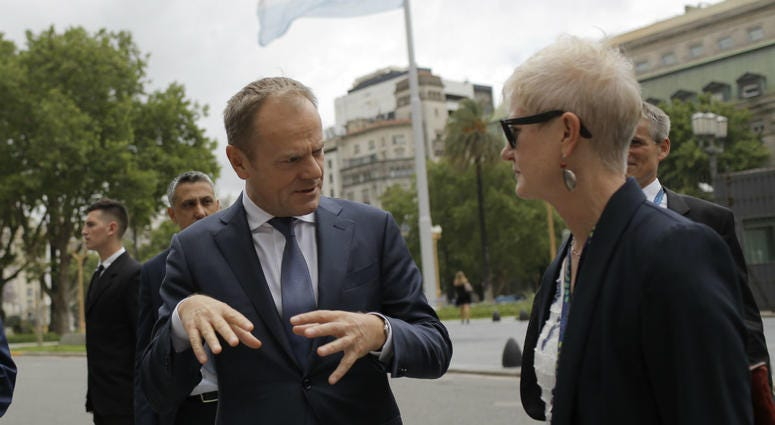 European Council's President Donald Tusk, left, leaves the presidential palace after meeting Argentina's President Mauricio Macri in Buenos Aires, Argentina, Thursday, Nov. 29, 2018.