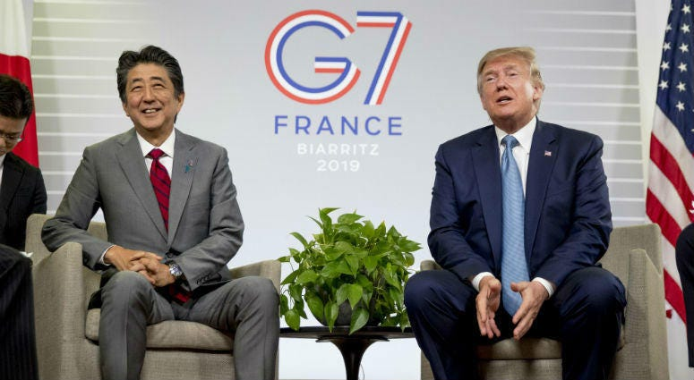 U.S President Donald Trump, accompanied by Japanese Prime Minister Shinzo Abe, left, speaks at a news conference at the G-7 summit in Biarritz, France, Sunday, Aug. 25, 2019, where they announced that the U.S. and Japan have agreed in principle on a new t
