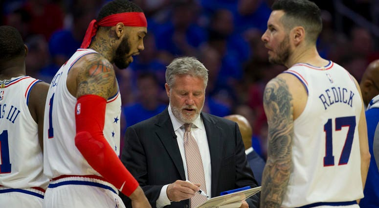 Brett Brown talks to Mike Scott and JJ Redick during Game Three.
