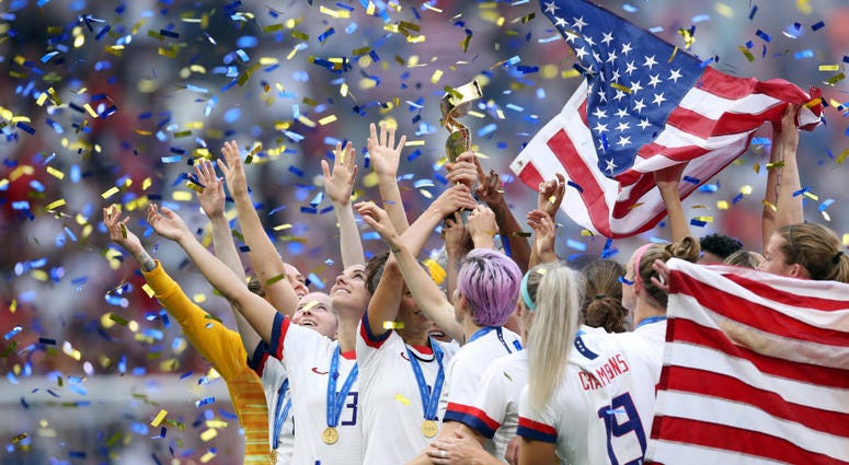 Carli Lloyd of the USA celebrate with the trophy following victory in the 2019 FIFA Women's World Cup France Final match between The United States of America and The Netherlands at Stade de Lyon on July 07, 2019 in Lyon, France.