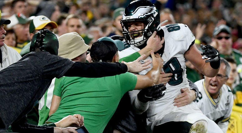 Dallas Goedert #88 of the Philadelphia Eagles celebrates his touchdown with fans in the second quarter over the Green Bay Packers during the game at Lambeau Field.