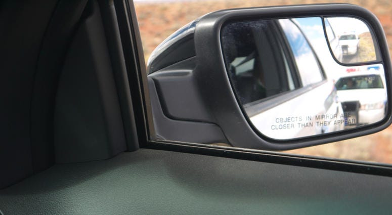 Police in the side-view mirror