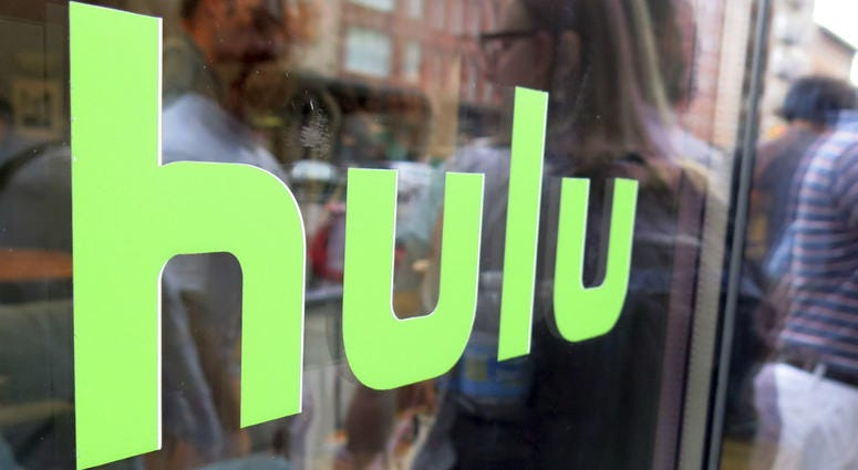 This June 27, 2015, file photo, shows the Hulu logo on a window at the Milk Studios space in New York. Disney has struck a deal with Comcast that gives it full control of streaming service Hulu.