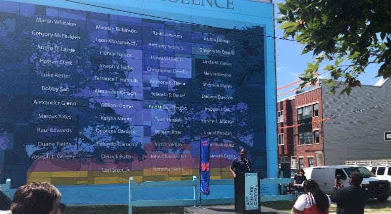 The anti-violence mural that struck community controversy a year ago when a developer mistakenly destroyed it has been officially restored and was dedicated Wednesday.
