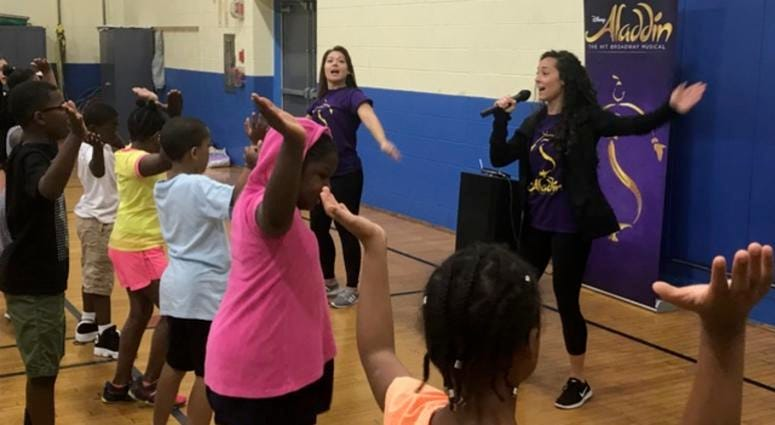 """some of the touring company's actors from """"Aladdin"""" stepped off stage to lead a special health and wellness workshop at the Christian Street YMCA for young fans."""