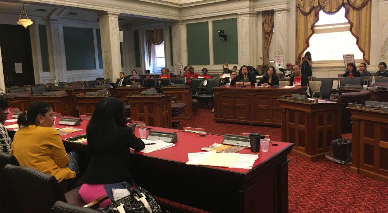 Advocate Erika Almirante, Janet Ginsberg of Community Legal Services and Allison Julian of the Domestic Workers Alliance testify.