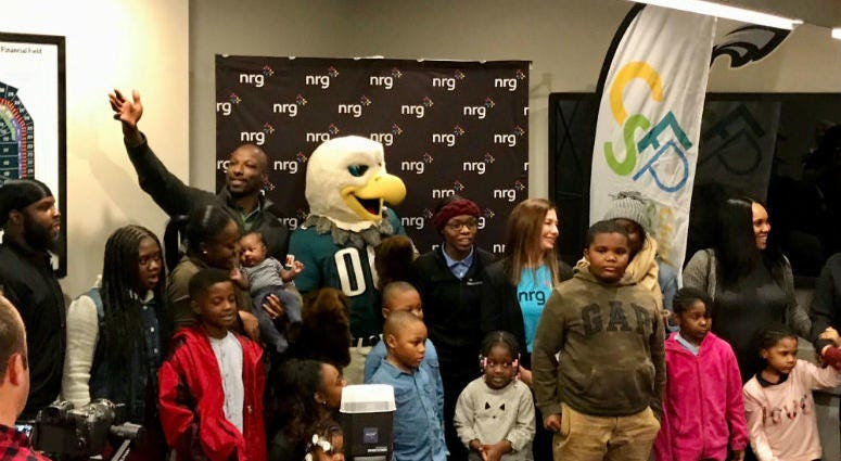 Families find out they win a scholarship at Lincoln Financial Field.