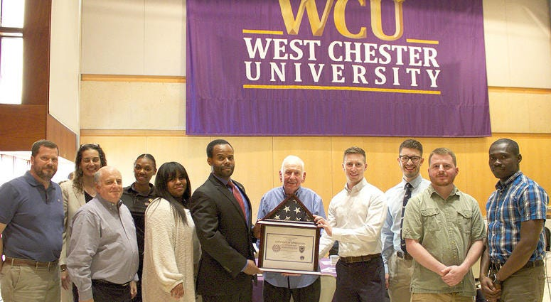 Lowell Gardenhour being honored during a ceremony on campus.