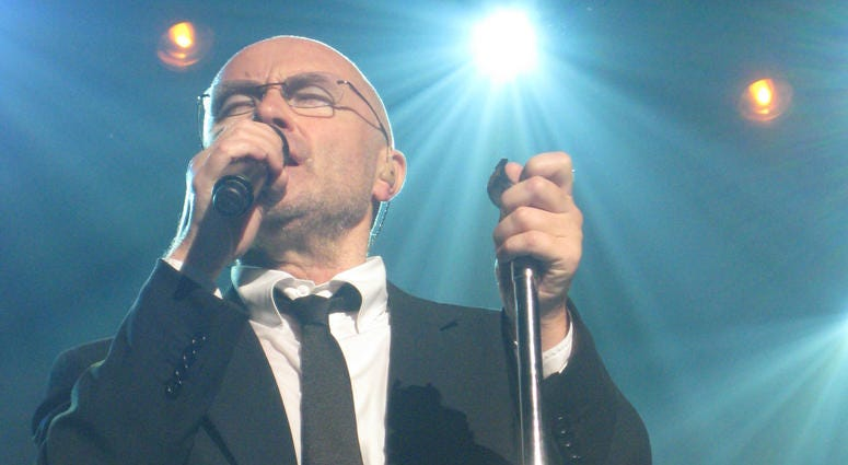 Phil Collins is shown performing in 2010