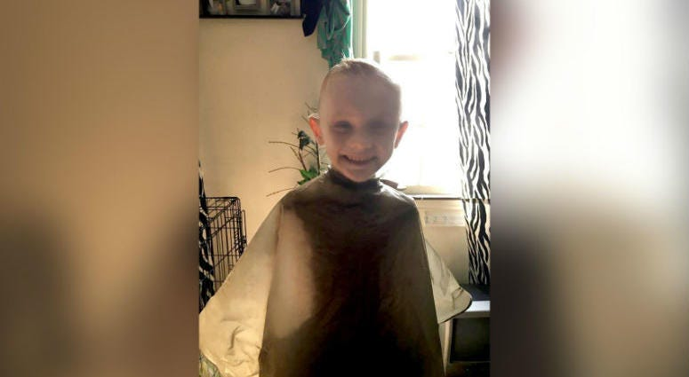 The body of a 5-year-old boy reported as missing last week was found wrapped in plastic in a shallow grave on Wednesday, and his parents have been charged with murder, police said.
