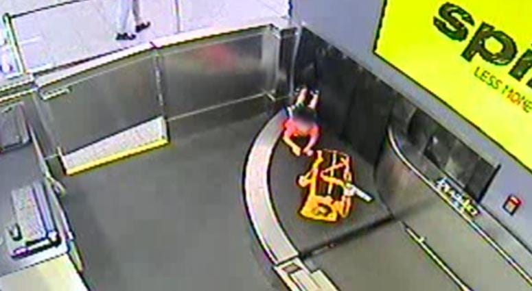 Child Stuck In Baggage Belt