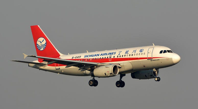 Flight 3U8633, operated by Sichuan Airlines, prepares to conduct emergency landing