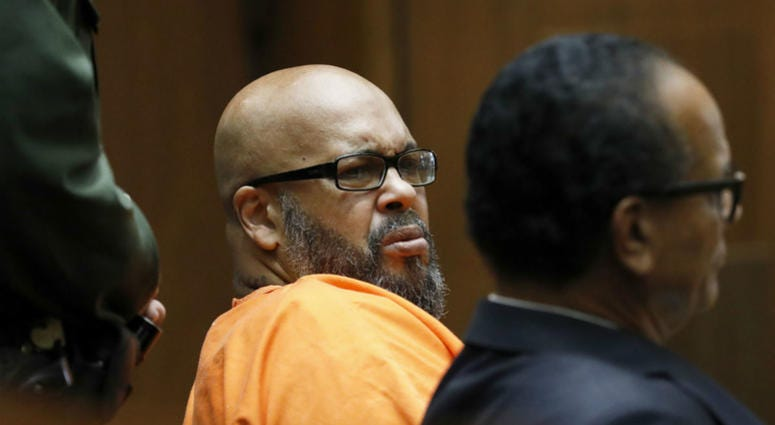 "In this Thursday, Sept. 20, 2018 file photo, former rap mogul Marion ""Suge"" Knight, left, with his defense attorney Albert DeBlanc Jr., listens to the terms of his plea of no contest to voluntary manslaughter."