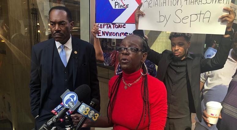 Philadelphia NAACP President Rodney Muhammad and former SEPTA employee Tera Bryant address reporters outside SEPTA headquarters.