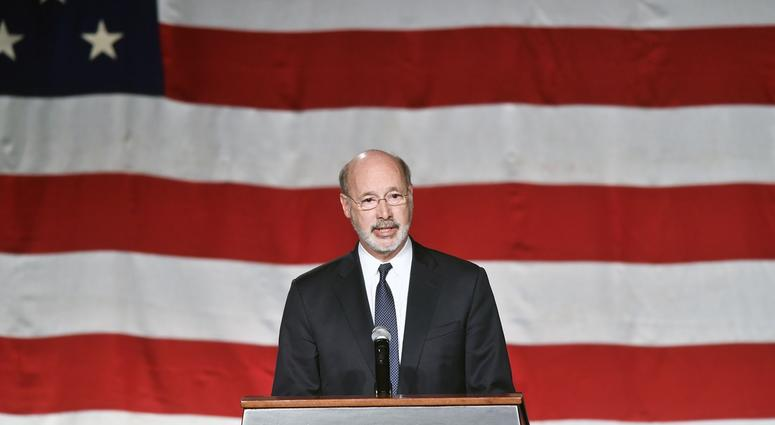 Pennsylvania Gov. Tom Wolf speaks at a public memorial service honoring York City firefighters Ivan Flanscha and Zachary Anthony at the York Expo Center.
