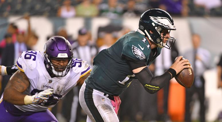Philadelphia Eagles quarterback Carson Wentz (11) scrambles away from Minnesota Vikings defensive tackle Tom Johnson (96) during the fourth quarter at Lincoln Financial Field.