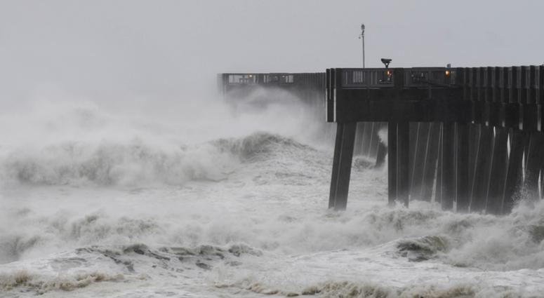 Waves crash over the end of the Panama City Beach Pier as Hurricane Michael approaches.