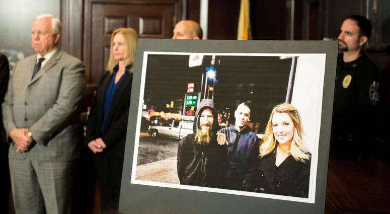An image of Johnny Bobbitt Jr., from left, Mark D'Amico and Katelyn McClure on display during during a press conference Thursday, Nov. 15, 2018 in Mount Holly, N.J.
