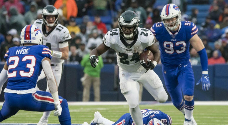 Philadelphia Eagles running back Jordan Howard (24) tries to avoid a tackle by Buffalo Bills strong safety Micah Hyde (23) and defensive end Trent Murphy (93).