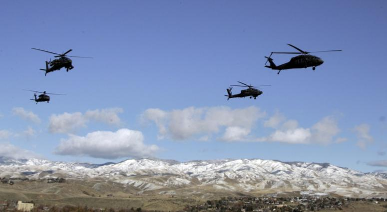 A flight of Apache and Blackhawk helicopter from the Idaho National Guard perform a fly over prior to the first half against the Idaho Vandals at Bronco Stadium.