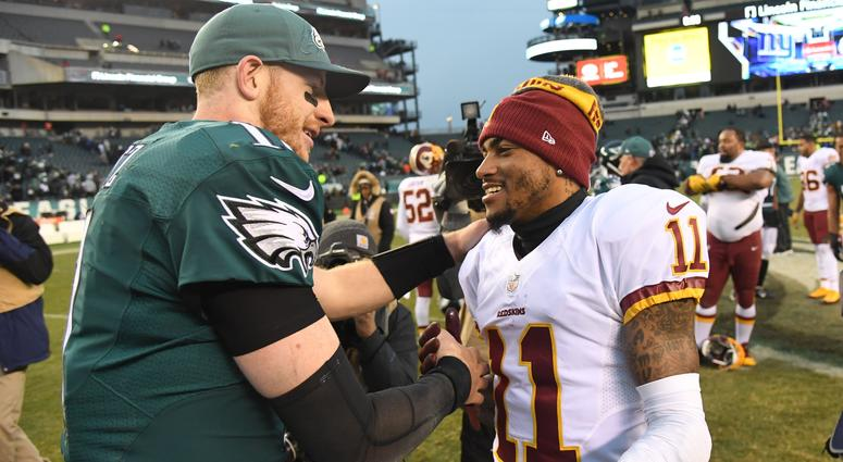 Philadelphia Eagles quarterback Carson Wentz speaks with Washington Redskins wide receiver DeSean Jackson.