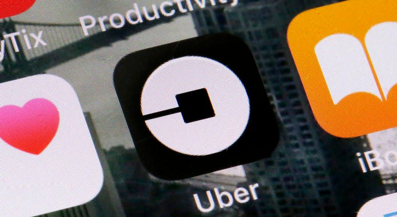 This June 12, 2018, file photo shows the Uber app on a phone in New York.