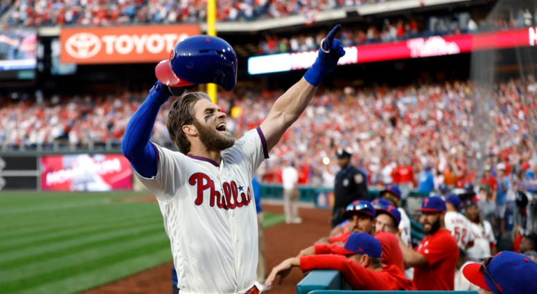 Philadelphia Phillies' Bryce Harper celebrates after hitting a home run off Atlanta Braves relief pitcher Jesse Biddle during the seventh inning of a baseball game, Saturday, March 30, 2019, in Philadelphia.