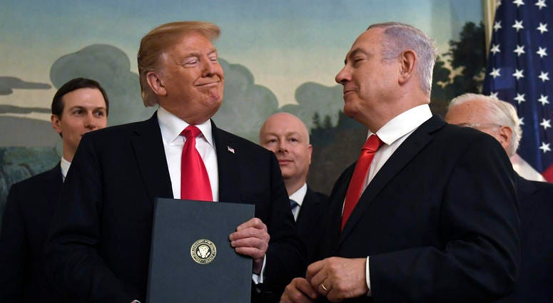 FILE - In this Monday, March 25, 2019 file photo, President Donald Trump smiles at Israeli Prime Minister Benjamin Netanyahu, right, after signing a proclamation in the Diplomatic Reception Room at the White House in Washington. Trump isn't on the ballot