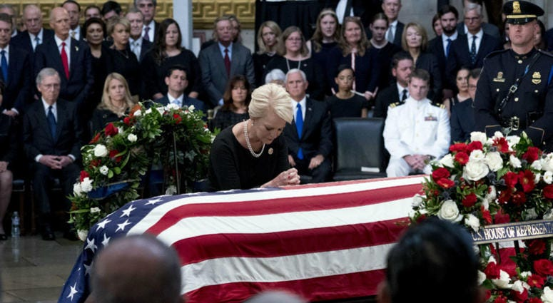 Cindy McCain, wife of, Sen. John McCain, R-Ariz., pauses at her husband's casket as he lies in state in the Rotunda of the U.S. Capitol, Friday, Aug. 31, 2018, in Washington.