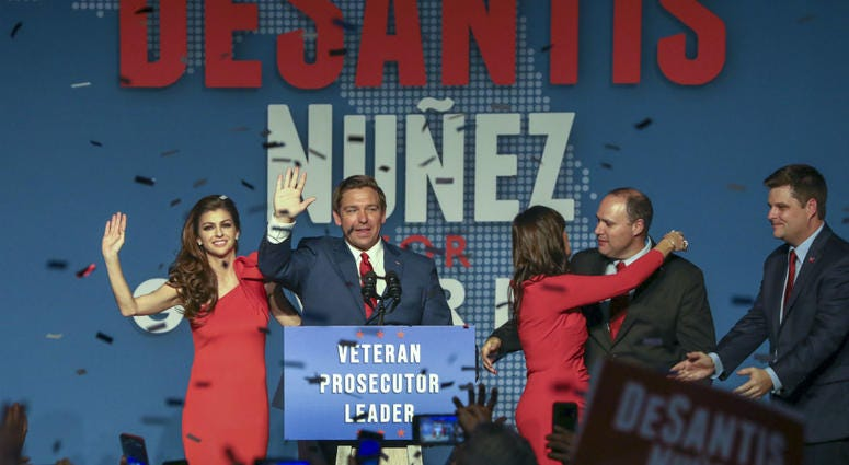 Republican Florida Governor-elect Ron DeSantis, center, waves to the supporters with his wife, Casey, left, and Republican Lt. Governor-elect Jeanette Nunez, third right.