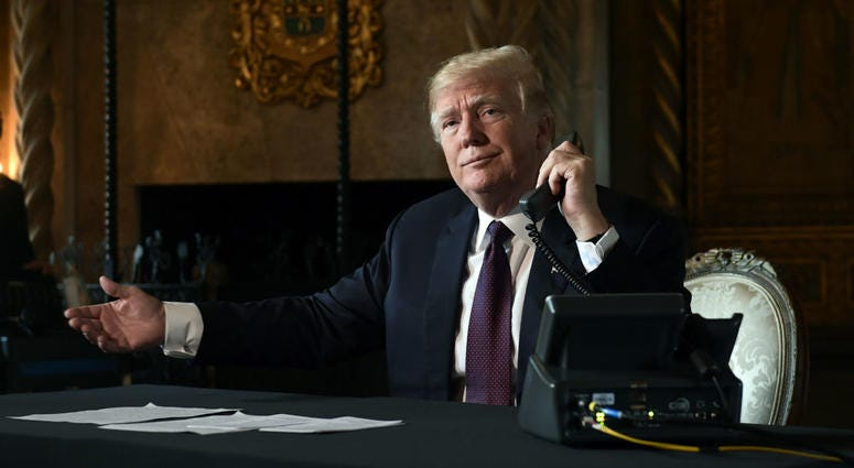 President Donald Trump asks if reporters can hear the audio as he talks with troops via teleconference from his Mar-a-Lago estate in Palm Beach, Fla., Thursday, Nov. 22, 2018.